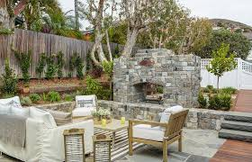 sunken patio with stone fireplace