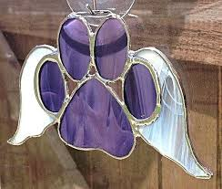 paw with wings stained glass sun