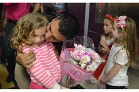 Gullett Elementary students wow families with performance - Adriana Campbell  gets flowers and a kiss from her dad, Wade. | Your Observer