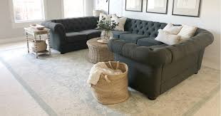 decorating with area rugs over carpet