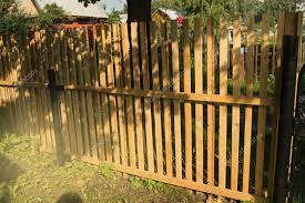 Rustic New Wooden Fence With Black Metal Posts And Gates Garden And Vegetable G Affiliate Fence B Wooden Fence Building A Fence Fenced Vegetable Garden