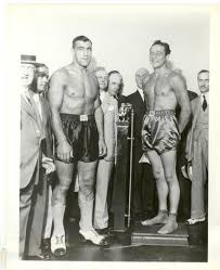 Primo Carnera vs Max Baer weigh-in, 1934. Baer would go to on knock down  Primo eleven times before succumbing to a KO in the 11th. : Boxing