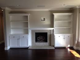 fireplace flush to wall with bookcase