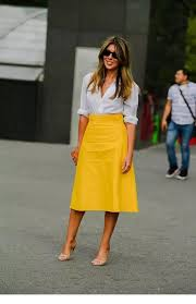 yellow leather skirt and white shirt