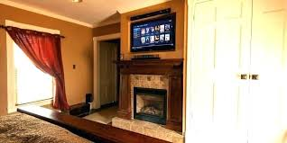 wall mounted tv above fireplace locco me
