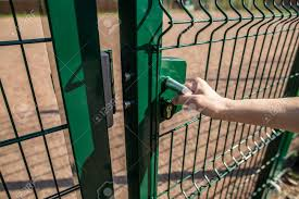 Person Wants Get In On Playground Through The Little Gate Of Stock Photo Picture And Royalty Free Image Image 70480529