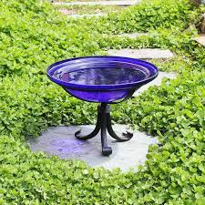 cobalt blue glass birdbath with small