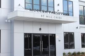 celebrates opening of modera parsippany