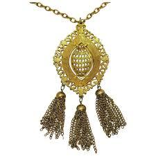 signed lisner vintage golden medallion