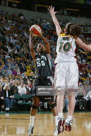 Vickie Johnson of the New York Liberty shoots over Sue Bird of the ...