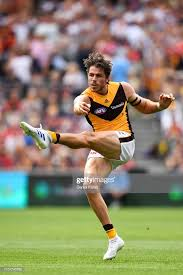 Isaac Smith of the Hawks kicks the ball during the round one AFL... News  Photo - Getty Images
