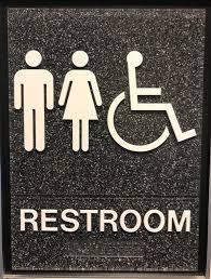 young signs gender nuetral bathroom