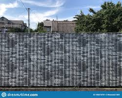 Background Texture Fence Of Thin Metal Profnasted Painted With Gray Paints Imitating Natural Stone Against Clouds Of Sky And Roofs Stock Image Image Of Symbol Seamless 185618791