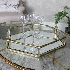 large antique gold hexagonal mirrored