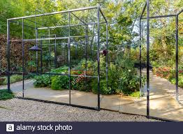 Urban Garden Design With A Black Steel Frame Enclosing The Walkway Through The Garden Stock Photo Alamy