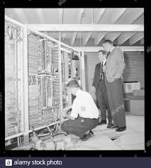 English: Wesley Graham (right) talking with IBM representative Chester  Warchol while someone works on setting up