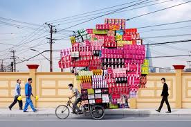 stacks of chinese goods piled high on bikes