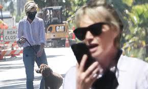 Ellen DeGeneres' wife Portia de Rossi wears a black mask as she walks her  dog   Daily Mail Online