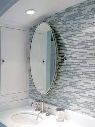 how to hang oval bathroom pivot mirror