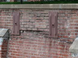 failing retaining wall repair in