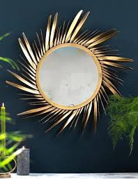 large gold feathered sunburst mirror in