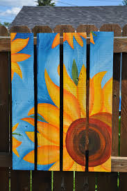 Another Use For Old Pallets Paint Away And Hang On The Outside Fence Instant Garden Fence Paint Fence Art Backyard Fences