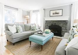 blue and gray living room with bench as