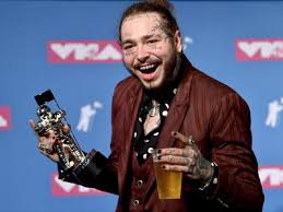 Post Malone got a haircut and an acting role to avoid a curse - Insider