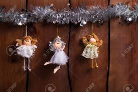 Three Fairies Weigh On A Wooden Fence Christmas Decorations Stock Photo Picture And Royalty Free Image Image 66522462