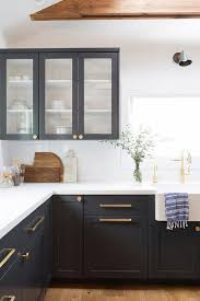 black shaker cabinets with brushed gold