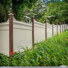 Brown And Tan Pvc Vinyl Privacy Fence Panels With Stepped Classic Victorian Picket Toppers From Illusions Vinyl Vinyl Privacy Fence Backyard Fences Vinyl Fence