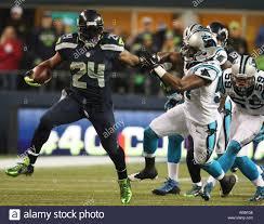 Seattle Seahawks running back Marshawn Lynch (24) stiff arms the ...