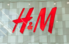 h m reports narrower profit decline