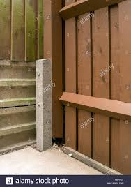 Reinforced Concrete Godfather Fence Post Spur Used To Repair Wooden Post And Rail Fence With Pails Stock Photo Alamy