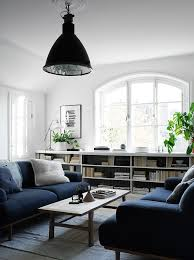 living room with two depp blue sofas