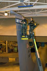 Us Air Force Usaf Technical Sergeant Tsgt Frank Stephens Left And Tsgt Mike Paquin Apply A Vinyl Decal Onto The Vertical Stabilizer Of A 157th Air Refueling Wing Arw Kc 135 Stratotanker