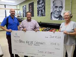 SCN Mission Committee presents Bread for Life food pantry with ...