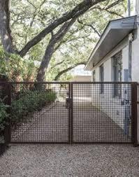 10 Garden Hacks With Rusted Metal Gardenista Ideas In 2020 Garden Gates Fence Design Landscape Design