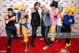 Christopher Sabat and Sean Schemmel pose with fans in costumes at ...