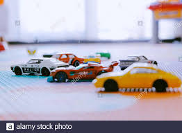 Little Colorful Toys Hot Wheels Cars By Mattel In Kids Room Play Mat Stock Photo Alamy
