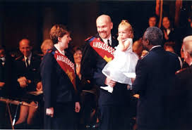 A color photograph of Hilary Lashawn Patterson, Dwayne Dalton Patterson,  daughter, and David Edwards at the 2002 Ambassadors of Grace Commissioning  Ceremony.
