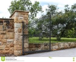 Wrought Iron Entrance Gate Set In Sandstone Fence Stock Photo Image Of Iron Fence 75571242