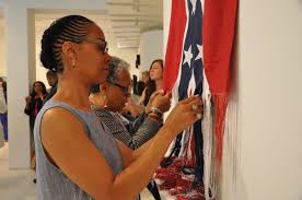Artist examines how to unravel a Confederate flag - The Boston Globe