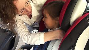 errors in child car seat use putting