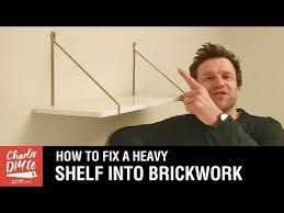 hang a heavy shelf on a brick wall