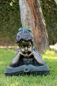 boy and girl reading together statue