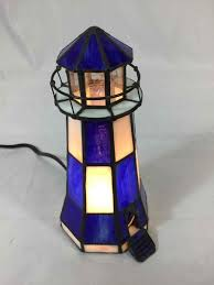 blue white lighthouse lamp