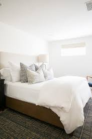 white platform bed with black and white