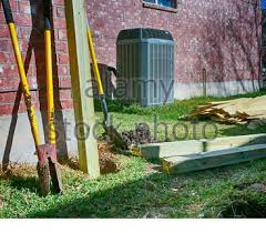 Building New Fence Backyard With Modern Air Conditioner Shovels And Lumber For New Privacy Fence Black And White Stock Photo Alamy