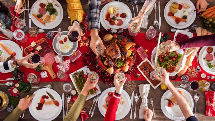 Image result for images of people eating and drinking to excess at christmas""
